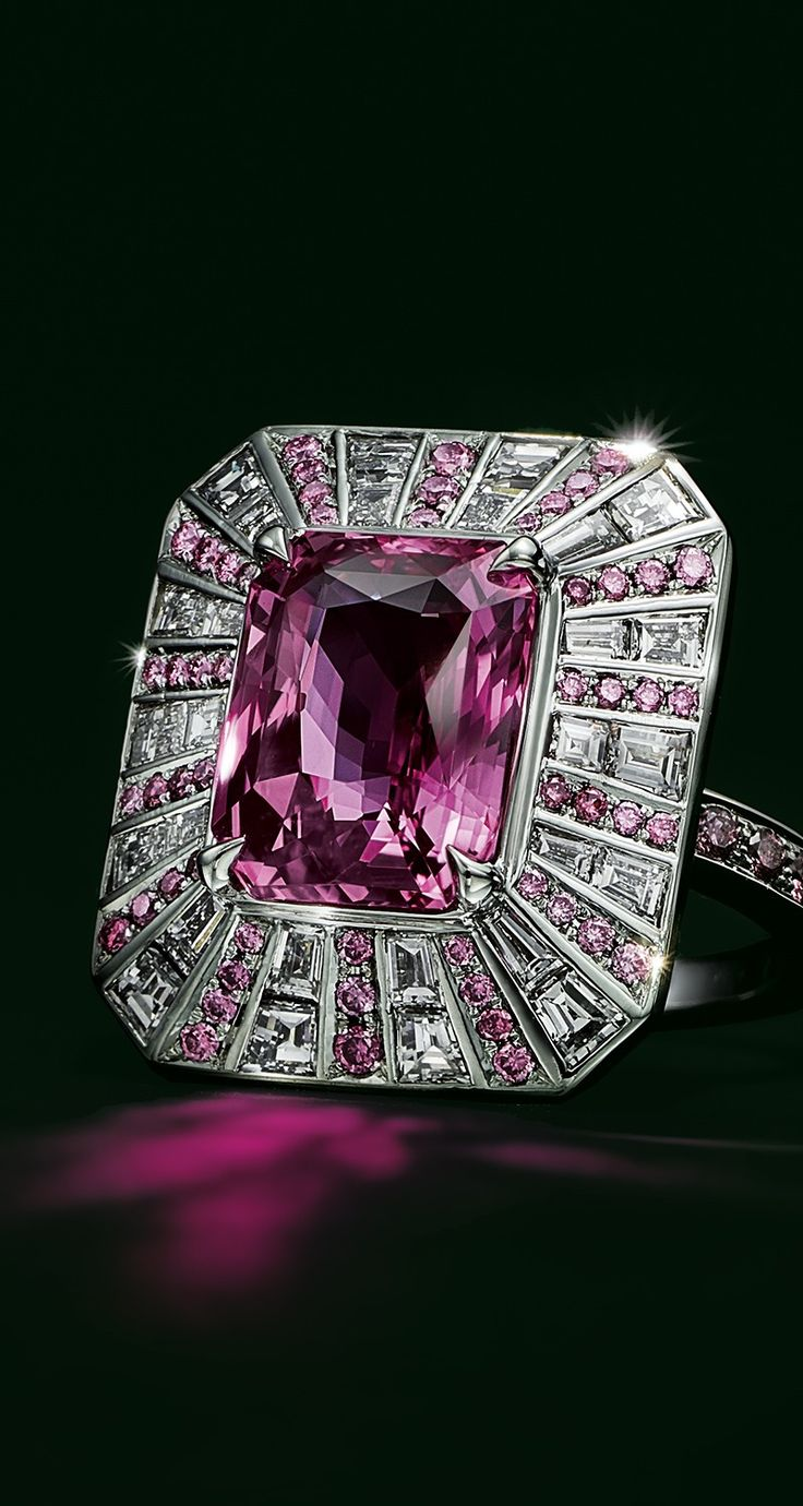 Set in platinum, pink and white diamonds encircle an unenhanced emerald-cut pink sapphire of over 6 carats.