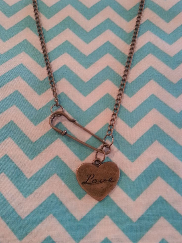 Safety pin love necklace.
