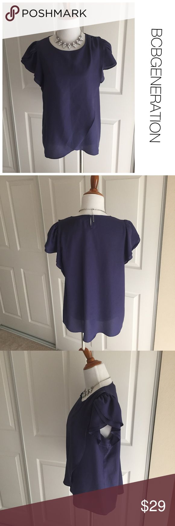 BCBGENERATION top with ruffle sleeve size M ♦️Excellent condition. No holes, stains or piling.                                                 ♦️Materials- 100% polyester    ♦️Measurements:                               ♦️Laying flat armpit to armpit: approximately 18 inches                       ♦️Laying flat from the back of the neck to the bottom of the front hem is approximately 27 inches BCBGeneration Tops Blouses