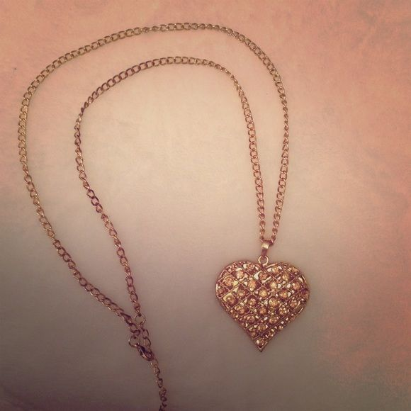 Heart shaped gold necklace Has slight pink faux diamonds in the heart pendant Icing Jewelry Necklaces
