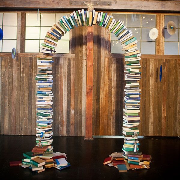 A wedding ceremony arch made from books