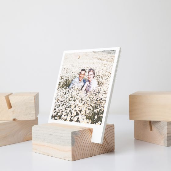 Make it a well-dressed desk! This gift item is a simple way to create a rotating art display with 12 of your photos that sit as textured paper prints in a wood block.