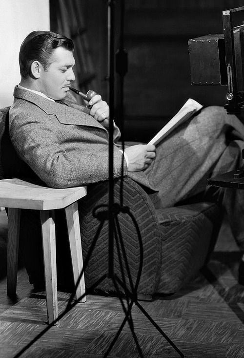 Clark Gable reading a script.