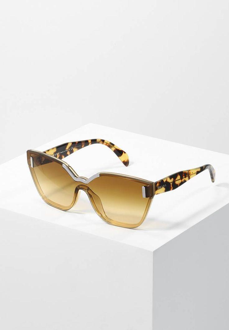Prada. Sonnenbrille - brown. Breite:15 cm bei Größe 48. Bügellänge:13 cm bei Größe 48. Stegbreite:1.5 cm bei Größe 48. UV-Schutz:ja. Brillenform:Monoscheibe. Brillenetui:Hartschale
