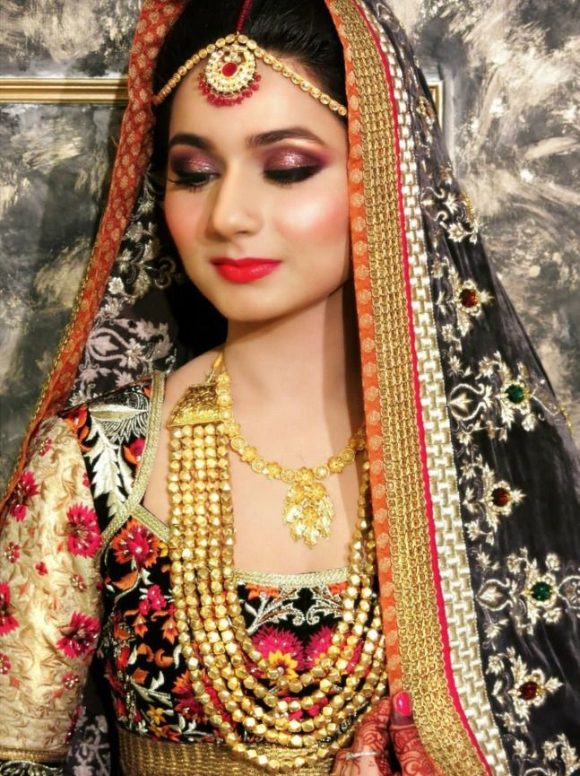 Traditional Indian bride wearing bridal lehenga, jewellery and hairstyle. Indian wedding photography.