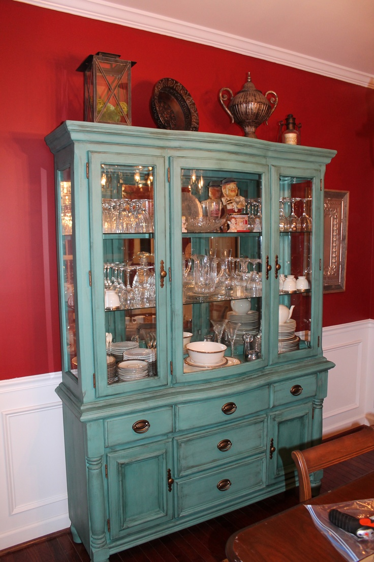 My china hutch makeover.  Painted fun turquoise using chalk paint, antique glaze and wax.  www.addressingspaces.com