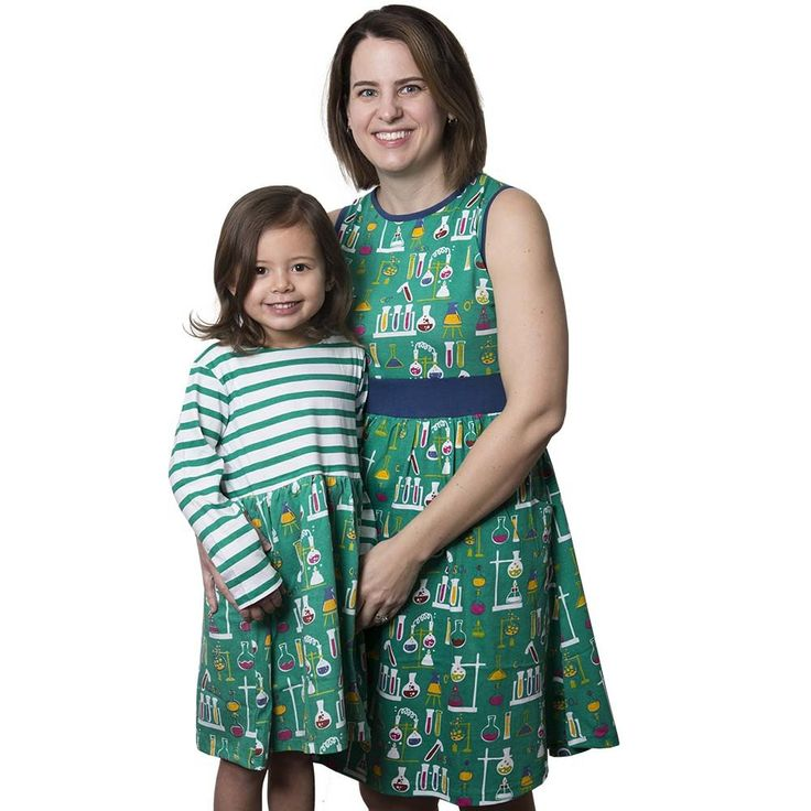 Science-inspired, turquoise, sleeveless, organic cotton women's dress with pockets & purple waistband. Features chemistry lab equipment design.  2-4X