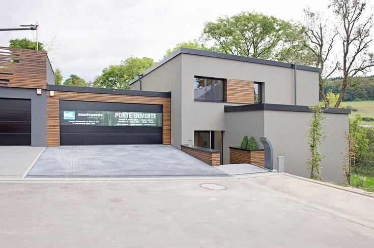 Hybrides und ökologisches einfamilienhaus aus beton und massivholz in mersch (luxemburg): häuser von massive passive
