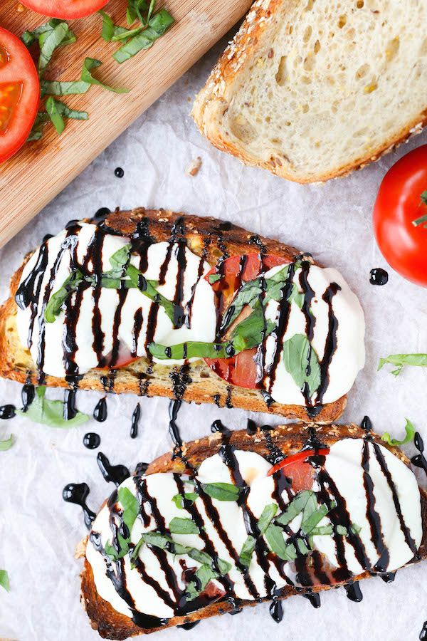 Open Faced Caprese Sandwiches - sliced tomato + basil + mozzarella + bread + balsamic reduction