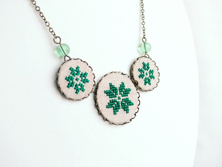 Geometrical green necklace with three cross stitch ethnic flower ornaments in bronze via Etsy.