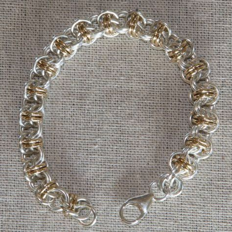 This bracelet is made from sterling silver and gold filled (14/20) jump rings, hand woven to create a stunning bracelet that is sure to get attention.  Large sterling silver lobster-claw clasp.  Length is 7 5/8 inches, weight is 1 1/8 oz.  To measure wrist: using a soft measuring