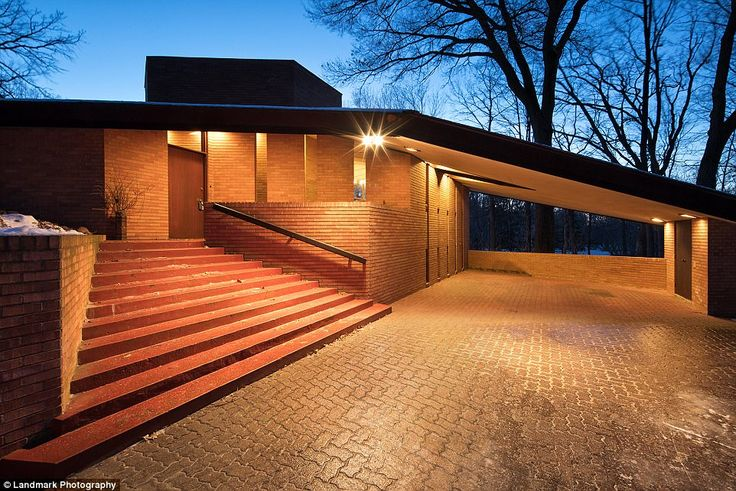 At night the sharp angles of the house make for a breathtaking sight as if you are headed into a theater not a house