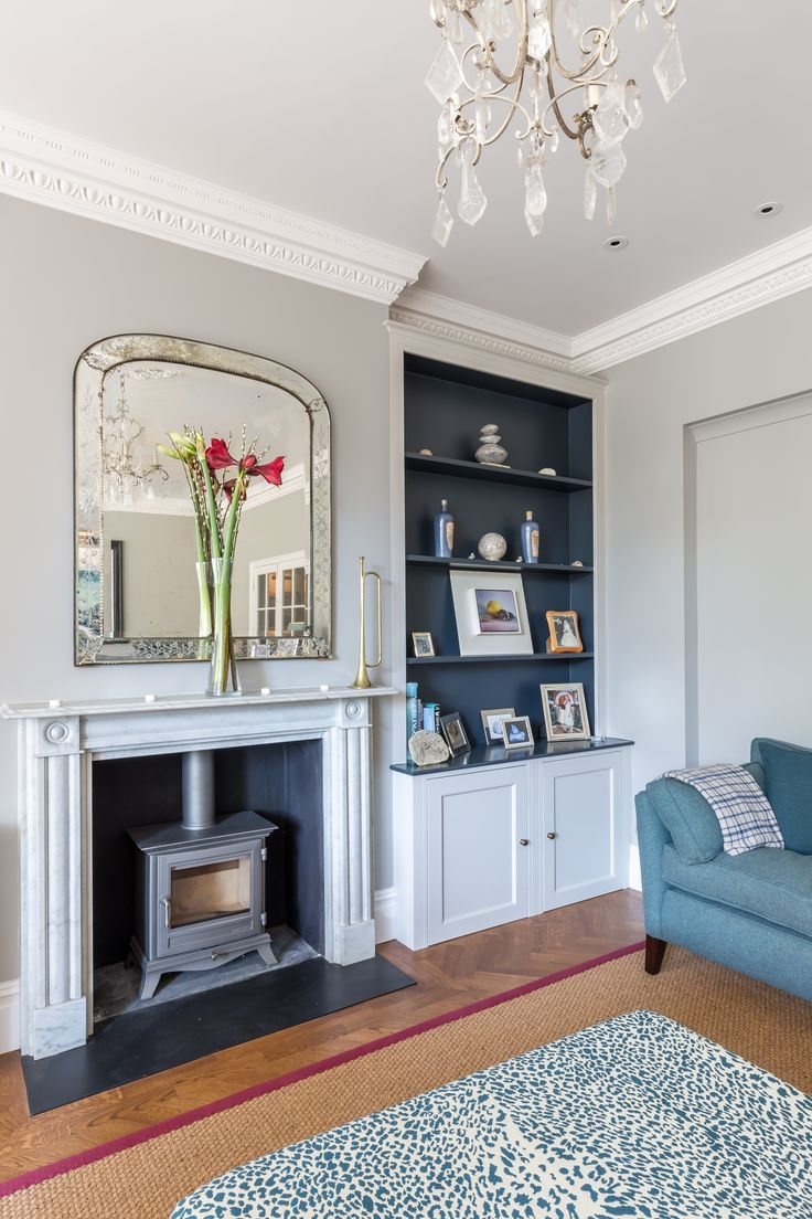Living room renovation to a stylish victorian property in London | original features | woodburner | parquet floor | fireplace | residential design | architecture | interior photography | architectural photography | howard baker photography
