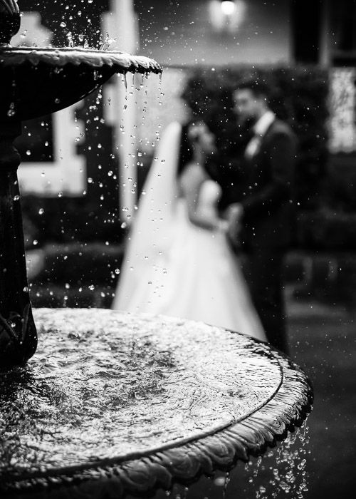 bride and groom with frozen water in fountain #wedding #weddingphotography #melbourne