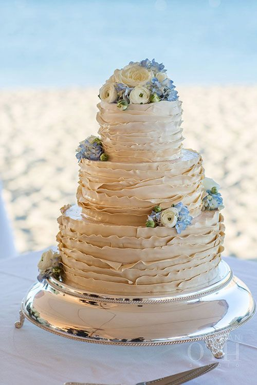 Three-Tiered Wedding Cake with Fresh Flowers | Brides.com