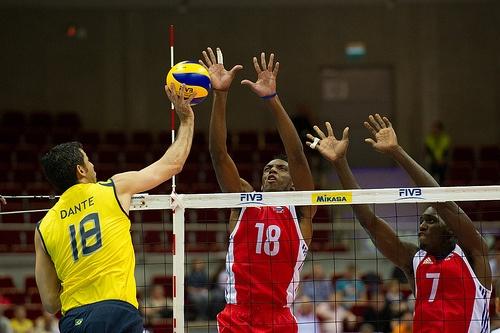 Dante Amaral of Brazil Volleyball Team spikes the ball against Diaz and Camejo of Cuba Volleyball Team Fot. Mariusz Pałczyński / http://www.facebook.com/MariuszPalczynskiPhotography