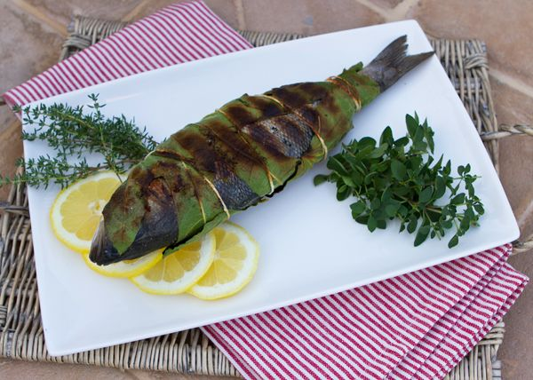 Grilled Whole Fish Wrapped in Fig Leaves With Piquant Sauce