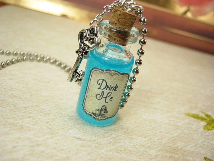So cute what little girl would not love this?!? Drink Me Glow in the Dark Bottle Necklace - Alice in Wonderland Vial Cork Charm