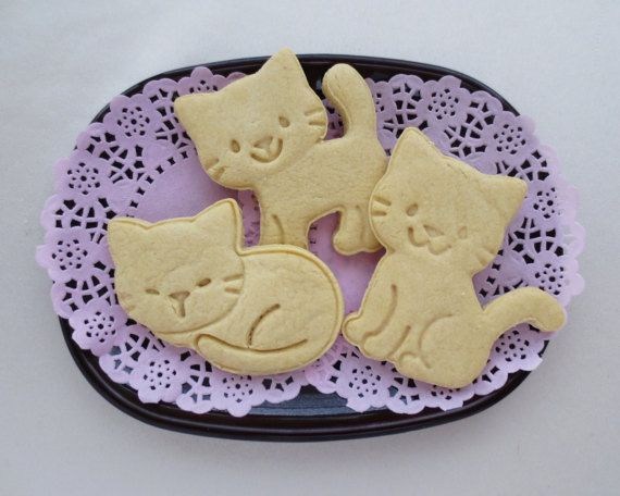 A set of cookie cutters and stamps in shapes of cute kitties! Its called Nyankies Cat Cookie Cutters. There are three kinds: sleeping, sitting & walking. Each one comes with a kitty paw button to stamp & push out the cookie dough out of the cutter.  These are made of ABS resin. The heat resistant temperature is 176 degrees Fehrenheit (80 degrees Celsius). However the instruction says that these are not Dishwasher-safe nor microwave-safe. (Its written in Japanese, so if you have any qu...