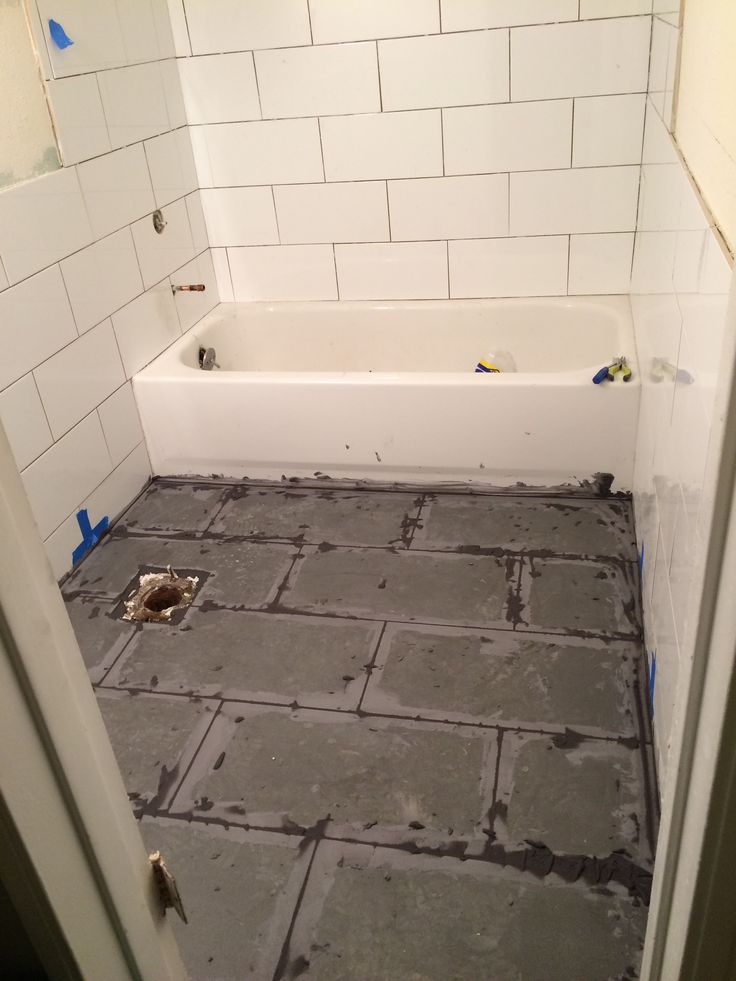 White subway tile grey grout bathroom