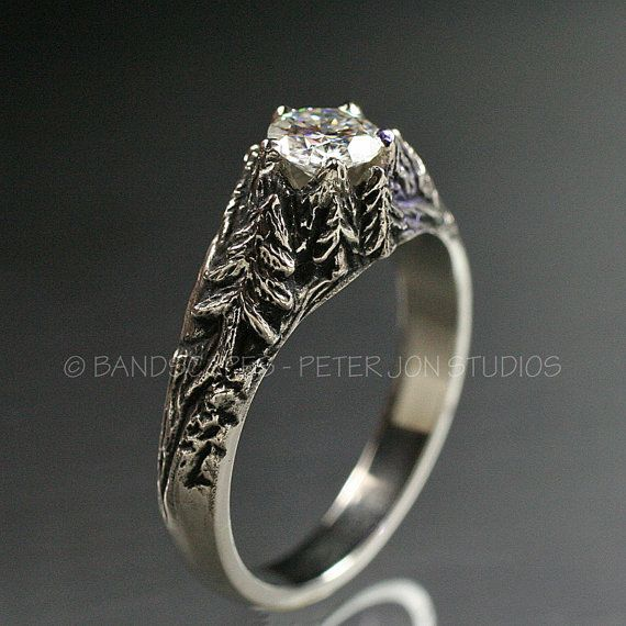 """Crystal Peaks"" 50ct Moissanite with 14k metal surround; $1,295 for the stunning trees as prongs design."