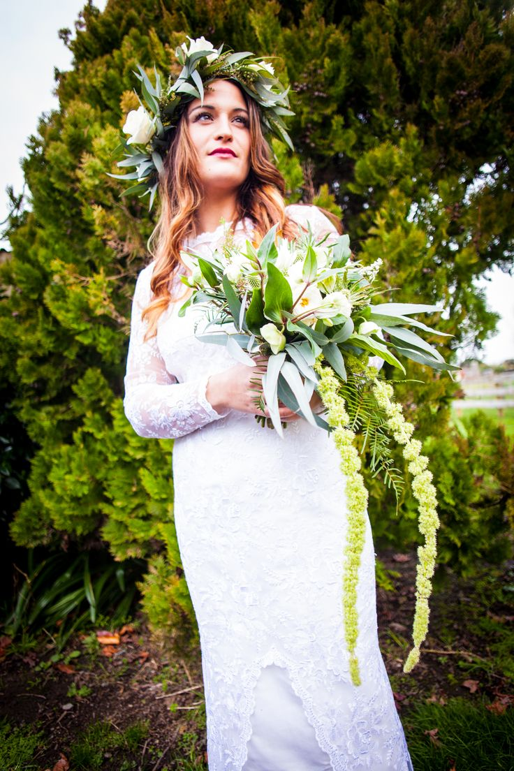 Winter greens and whites floral crown or headpiece with trailing bridal bouquet. Flowers and styling by one poppy wedding flowers Auckland, photography by The Unmissable.