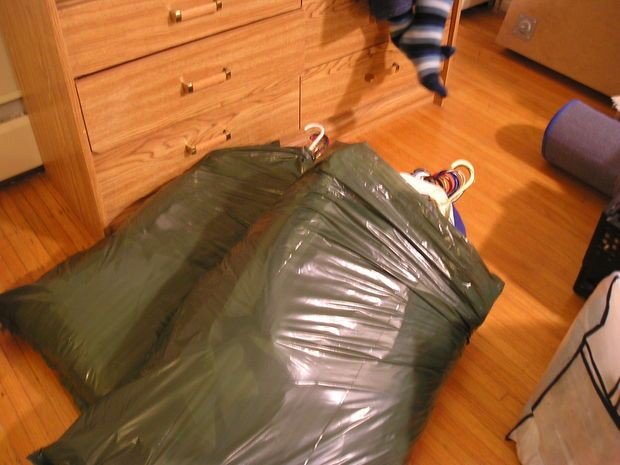 Put hanging clothes in a garbage bag to move them to a new place