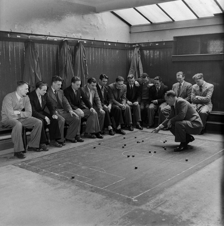 Players of Southampton Football club are given tactical instruction by the manager in the dressing room. March 1949