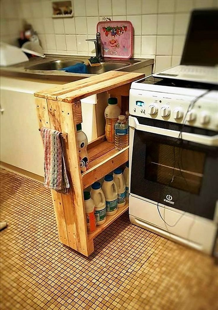 Using pallet wood you can create small storage hacks any where in your home. Just need basic intelligence and tools. This small and simple sleek pallet wood pantry besides your cooking range is providing you space to organize your kitchen stuff in a tidy manner. Its simple and visually nice.