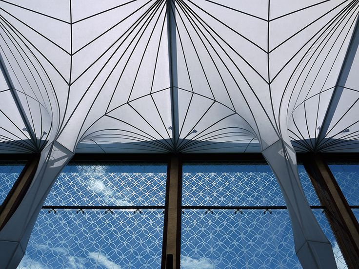 Merah Putih Restuarant in Bali.  Check out this fantastic roof.  Translucent water capture system that funnels it into the ground for storage and reuse!  AMAZING...    Concept & Design
