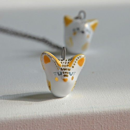 fennec fox necklace  This little dessert fox can't wait to travel around the world with you.  This item is 100% handmade high quality ceramics, glazed. Three times fired. Decorated with genuine gold. Comes with chain.
