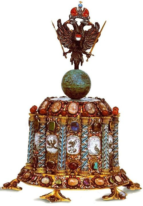 Table clock, power crowned with double-headed eagle. 1680. Silver, gold, precious and semi-precious stones, gold plating, enamel, carving. Bavarian State Office of castles, royal residence. Munich Germany. Made in Augsburg