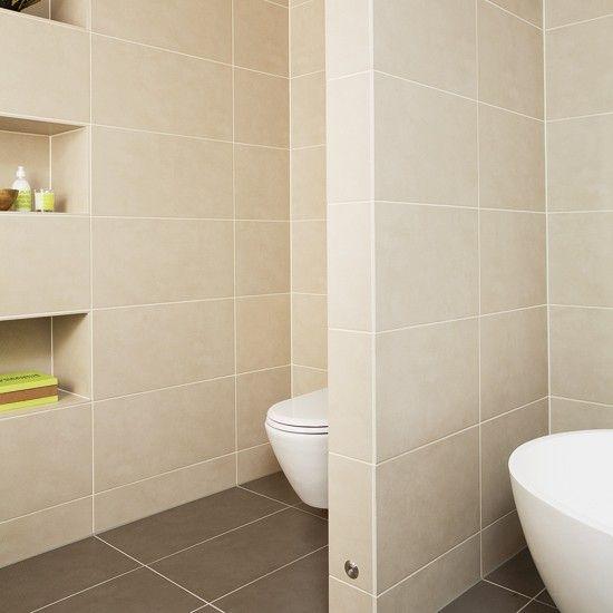 Beige bathroom with stud wall