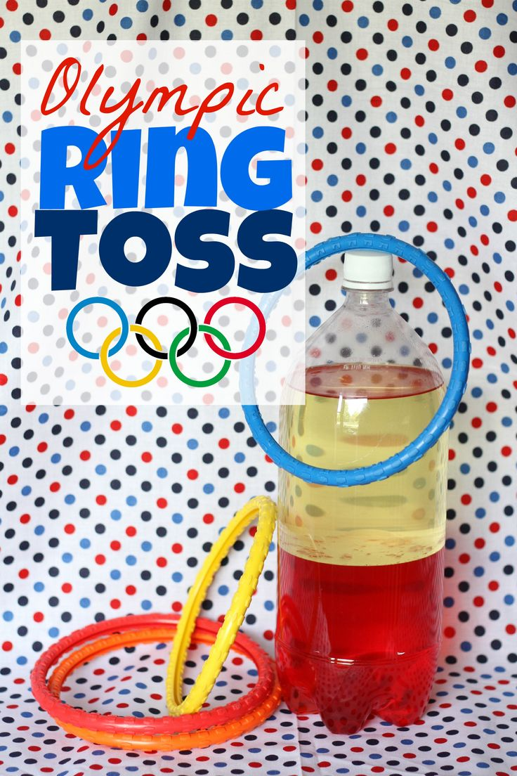 With a little imagination, simple diving rings can be transformed into an Olympic event! Here's what you'll need:  diving rings; a 2-liter bottle filled wi