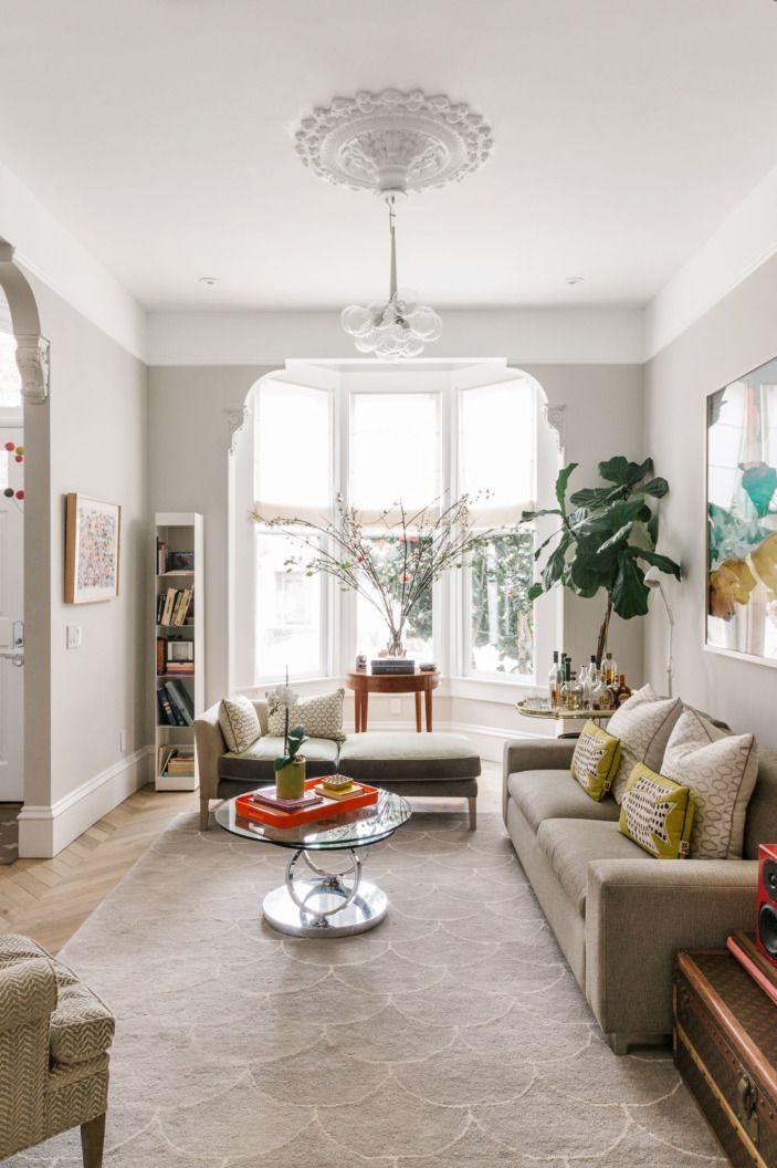 "When Homepolish designer Annouchka Engel and her husband David moved cross-country from New York to San Francisco, they found a stunning 1876 Victorian townhouse. The foundation and bones of the home were amazing, but the rest was ""a glorified frat house,"" according to Annouchka. Instead of shying away from a challenge, she took the opportunity to make the home a sunny reflection of who they are, bringing in European sensibility and artistic touches."