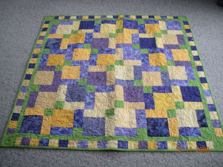 Group quilt for charity - featuring disappearing nine patch blocks.