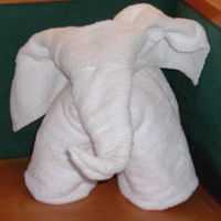 How to fold a towel elephant.  This would be a cute way to leave new towels as a thank you gift to a host/hostess.