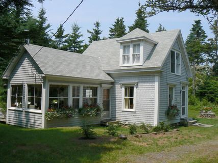 Small Cottage With Large Sun Room Addition