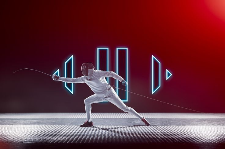 Fencing player isolated on black red gradient background by chernovphoto