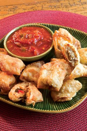 Sausage Wontons - Filled with cream cheese, ground red pepper, and ground sausage, add a kick to your table and are perfect for breakfast or brunch. - Cottage Journal