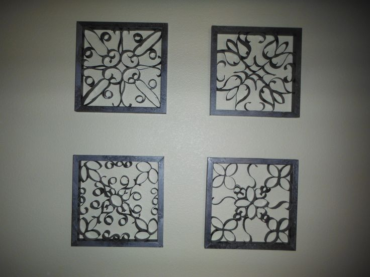 Made with scrap wood and toilet paper rolls, looks like wrought iron wall art