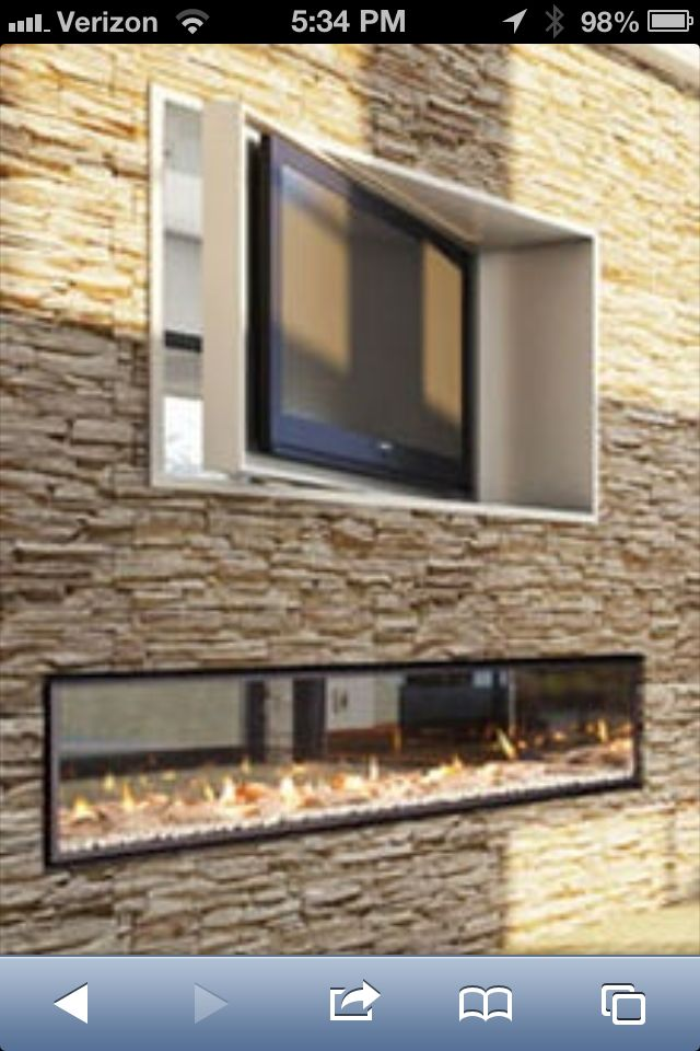 Yes please! Dual fireplace with rotating television unit