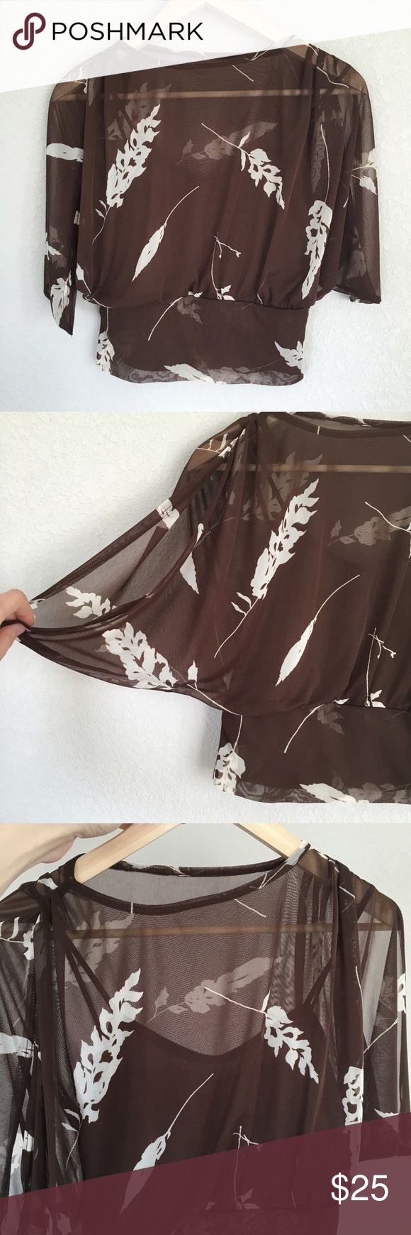 """Brown and White Floral Top Excellent condition top that features a brown cami sewn into a sheer brown floral overlay. Batwing-type sleeves have open slits on the arms. 100% polyester, hand wash cold, hang dry. Measures 13"""" flat across bottom waist band that hits just above or at pants (depending on your torso length). Made in USA. Flat measurements: 13"""" across bottom (has elastic for stretch up to 18""""); sleeve length 17""""; boat neck opening 9"""" across; length 19.5"""". Hot Sauce Tops Camisoles"""