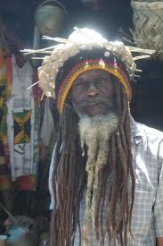 So, who is a Rastaman? One who practices the Jamaican religion and philosophy of Rastafarianism. Yes, this does include the usual image of a dark man with very long dreadlocks; ganja is involved most of the time; coincidentally, the Rasta character is always smiling!