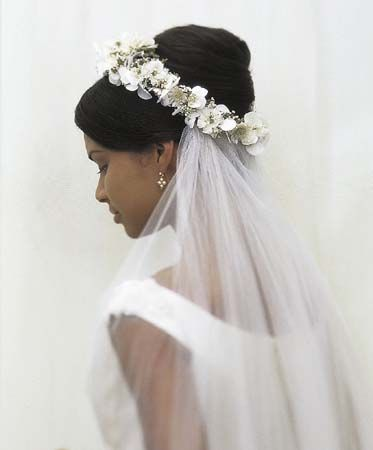 Bride wearing a floral Wreath with a Veil. This is what my mom used to get married.