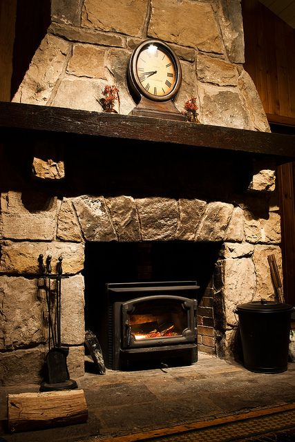 I've never really understood why people put inserts into beautiful fireplaces....but I still like this.Wood Burning Stoves, Fireplaces Mantles, Stones Fireplaces, Fireplace Mantles, Austin Texas, Living Room, Outdoor Fireplaces, Logs Cabin, Mantles Wood Stoves Insert