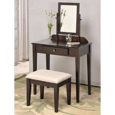 Phenomenal Percival Vanity Set with Mirror is an appreciable addition to your bedroom or bathroom. It creates an enthusiastic personal space. This magnificent Vanity set features a table with one drawer highlighted with a bronze knob, single mirror that swivels.