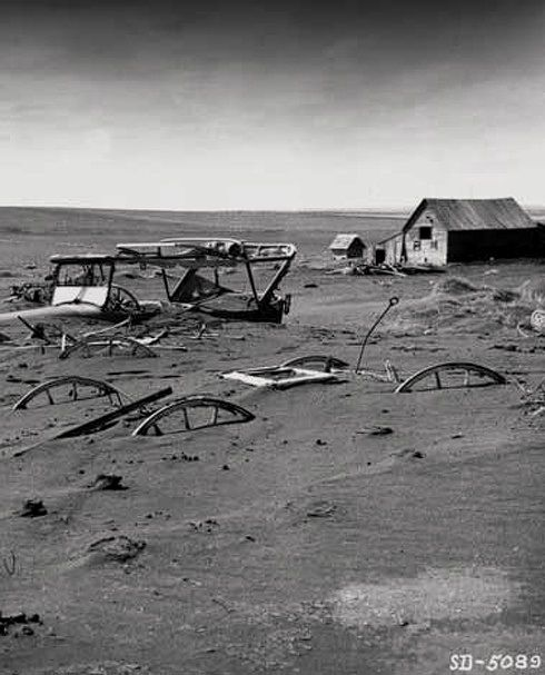A farm is buried during the dust bowl years, early 1930s.