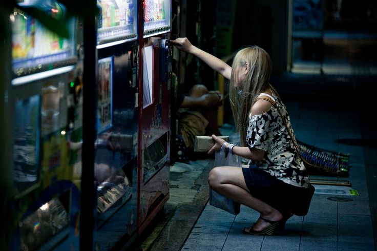 https://flic.kr/p/8yXfne | Odd | There are 2 oddities in this picture.   1. Why did she need to stoop to use the vending machine?  2. Where have the black borders gone?  I don't know about the answer to the first question but I do know the second.  I couldn't crop the image to a widescreen mode without making the image looks worse! Note to self - should have left some space for cropping next time.  My Facebook Page