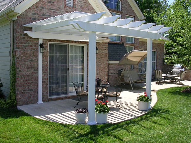 A drab patiocan be transformed by installing a low-maintenance vinyl pergola kit! By adding a shade structure to this patio, the homeowner was able to increasethe use of this outdoor space! An attached pergola kit utilizes a smaller footprint with only two columns allowing more space for furniture and guests.A fan block was added